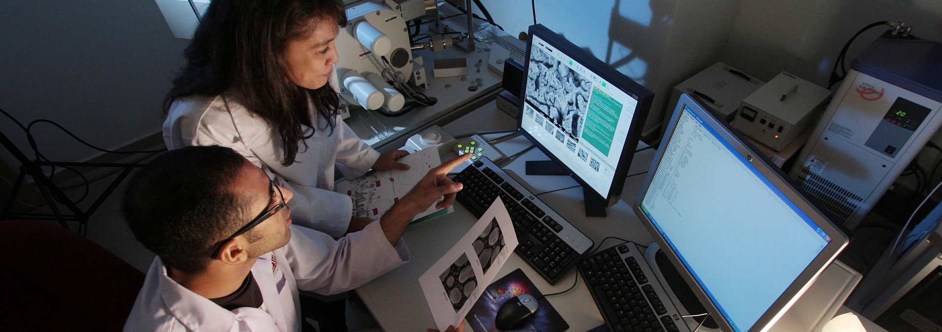 Crohn's and Colitis researchers looking at imagery on a computer