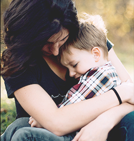 Woman comforting a child who shows symtoms of  Crohn's disease or ulcerative colitis